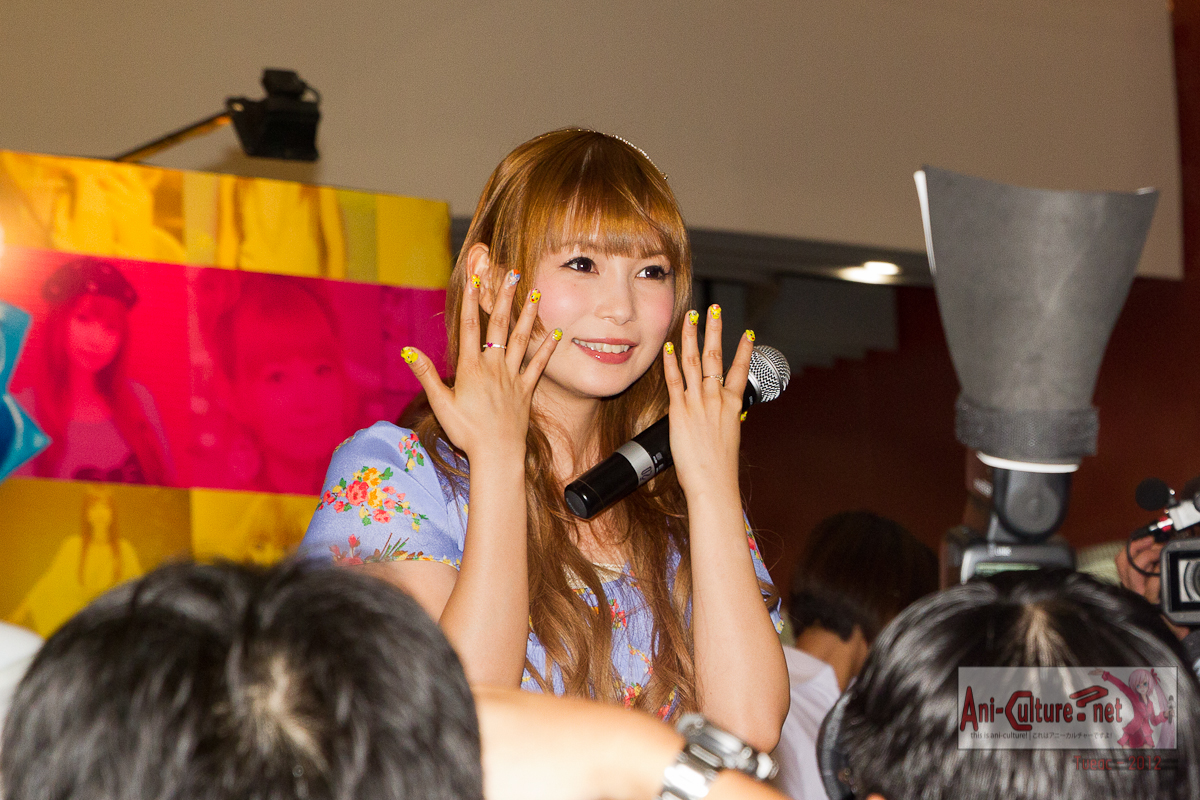 Shoko Nakagawa showing off her 3D Pokemon nail art, when the MC mentioned how cute it is.